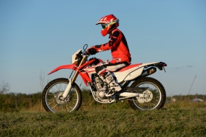 Man Riding Motocross Motorcycle